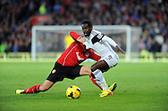 Nathan Dyer of Swansea City is tackled by Andrew Taylor of Cardiff City.<br /> Barclays Premier League match, Cardiff city v Swansea city at the Cardiff city stadium in Cardiff, South Wales on Sunday 3rd Nov 2013. pic by Phil Rees, Andrew Orchard sports photography,