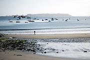 A man runs on the beach in Perros Guirec, Bretagne, France.<br /> <br /> © Giorgio Perottino