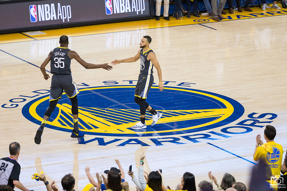 Golden State Warriors guard Stephen Curry (30) celebrates a made basket with Golden State Warriors forward Kevin Durant (35) at Oracle Arena during Game 2 of the Western Semifinals against the New Orleans Pelicans in Oakland, California, on May 1, 2018. (Stan Olszewski/Special to S.F. Examiner)