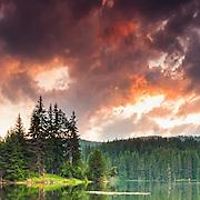 Beautiful mountain lake with green reflections at sunset