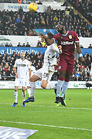 Football - 2018 / 2019 Championship - Swansea City vs Aston Villa<br /> … at the Liberty Stadium.<br /> <br /> Yannick Bolasie of Aston Villa heads at goal challenged by Connor Roberts of Swansea City<br /> <br /> Credit: COLORSPORT/Winston Bynorth