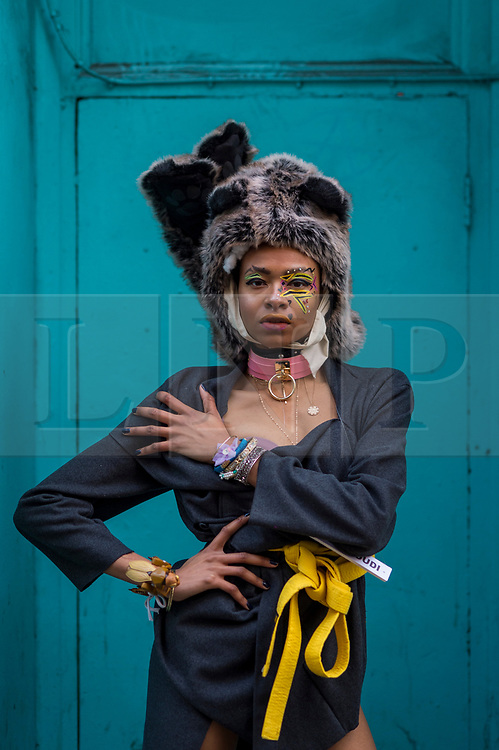 © Licensed to London News Pictures. 28/11/2020. LONDON, UK.  A model takes part in a flashmob through the West End for designer Pierre Garroudi.  Photo credit: Stephen Chung/LNP