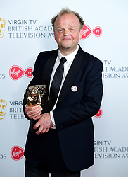Toby Jones with his award for Male performance in a comedy programme in the press room at the Virgin TV British Academy Television Awards 2018 held at the Royal Festival Hall, Southbank Centre, London.