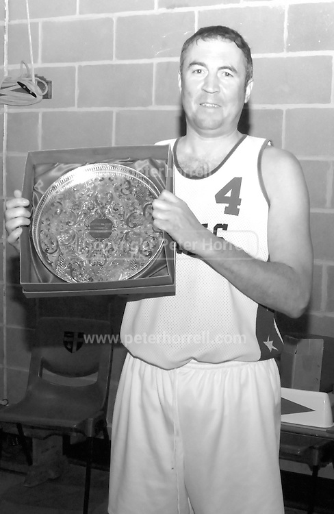 DAGENHAM - MAY 17: Player, coach and chairman of Barking and Dagenham Erkenwald Basketball Club, Declan McCusker holds the Ernie Oliver Memorial Trophy at the end Essex Metropolitan Basketball League Play Off final against Cardinals at Sydney Russell School. Erks won the game 81 - 68.