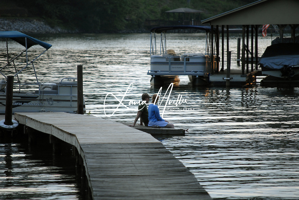 LAKE NORMAN - A couple enjoys dusk on a Lake Norman Dock -  photo by Laura Mueller