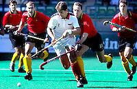 10th Men's World Cup Fieldhockey. Belgium vs Spain. Belgium defenders try to stop Spanish Pol Amat. fltr Marc Coudron (belgium), Pol Amat (Spain), Vitali Kholopov and Xavier-Charles Letier (both Belgium).