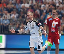 31.05.2014, Lanxess Arena, Koeln, GER, EHF CL, MKB MVM Veszprem vs THW Kiel, Halbfinale, im Bild Gudjon Valur Sigurdsson (THW Kiel #9) beim Torjubel mit Momir Ilic (MKB Veszprem #13) enttaeuscht // during the EHF Champions League semifinal match between MKB-MVM Veszprem and THW Kiel at the Lanxess Arena in Koeln, Germany on 2014/05/31. EXPA Pictures © 2014, PhotoCredit: EXPA/ Eibner-Pressefoto/ Schueler<br /> <br /> *****ATTENTION - OUT of GER*****