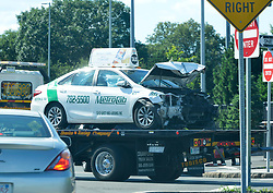 Jul 3, 2017 - Boston, Massachusetts, U.S. - A taxicab is towed away after the vehicle drove into a crowd of people at Logan International Airport in East Boston on Monday afternoon. Ten cab drivers were injured, one seriously, as another cab driver drove into them at the Logan Airport Taxi pool area near Porter Street and Tomahawk Drive. Police are ruling out terrorism at this point. The driver was reported to have said the Toyota Camry taxicab accelerated suddenly and was out of control. (Credit Image: © Kenneth Martin via ZUMA Wire)