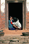 Young girls inspecting for nits, Patan, Nepal.