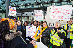 London, UK. 10th April 2019. Zita Holbourne, National Vice-President of the Public & Commercial Service (PCS) union, introduces Shadow Secretary of State for Business Energy & Industrial Strategy Rebecca Long-Bailey and Shadow Minister for Business, Energy and Industrial Strategy Laura Pidcock to outsourced workers belonging to PCS on a picket line outside their place of work at the Government Department for Business, Energy and Industrial Strategy (BEIS) during strike action to demand a real living wage of £10.55 per hour (the Living Wage Foundation's London Living Wage) and terms and conditions comparable with civil servants who work in the same department.