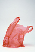 Still life of a red plastic shopping bag.