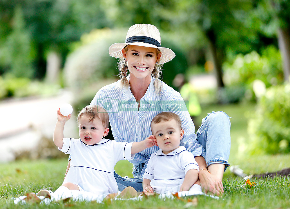 **EXCLUSIVE** Photo Credit: MOVI Inc. Date: July 17th 2019 Family Time! After a few months of family turmoil, first with husband Jim Edmonds' sexting scandal and then with her baby son Hart's brain damage diagnoses, Meghan King Edmonds takes some time to hang with her one-year-old twin boys, Hart and Hayes outside her home in St Louis, Missouri. The former Real Housewives alum, who is determined to keep her marriage in tact, stunned in some ripped jeans, dress shirt and a fedora hat. One-year-old Hart was recently diagnosed with a mild form of brain damage thought not to be progressive and the family are hoping that he will not need more therapy by the time he starts kindergarten. 17 Jul 2019 Pictured: Meghan King Edmonds, Hart Edmonds, Hayes Edmonds. Photo credit: MOVI Inc. / MEGA TheMegaAgency.com +1 888 505 6342