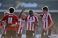 Brentford's Clayton Donaldson (c 9) celebrates with his teammates after he scores his sides 1st goal.  .Skybet football league one match , Brentford v Bradford City at Griffin Park in Brentford, London  on Saturday 8th March 2014.<br /> pic by John Fletcher, Andrew Orchard sports photography.