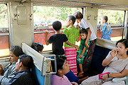 Inside a carriage on the Yangon Circular Railway on 16th May 2016 in Yangon, Myanmar. The railway, a narrow gauge local commuter trail network serving Yangon metropolitan area is a 28.5 mile 45.9 km 39 station loop system. This British built rail-loop connects Yangon to its satellite towns and villages