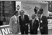 Nissan International Cycle Race..1986..01.10.1986..10.01.1986..1st October 1986..The Nissan Classic began today from Trinity College,Dublin. The offical race starter was The Taoiseach,Dr Garrett FitzGerald TD. He was accompanied by the Minister for Sport,Mr Sean Barrett TD..Sean Kelly was returning to defend his title but his opposition included Greg LeMond, the 1983 world champion and the winner of the Tour de France of the previous July. Roche was out due to his injured leg. Adri van der Poel was back with 1980 Tour de France winner and 1985 world champion Joop Zoetemelk. Teun van Vliet was back too. The winner of the green jersey of the Tour de France that July, Eric Vanderaerden was there as well as Australians Phil Anderson and Alan Peiper as well the Scottish cyclist Robert Millar...Representatives of Nissan Ireland are pictured with the Minister for Sport Mr Sean Barrett TD.