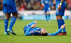 Leicester City's Vicente Iborra lies injured on the pitch