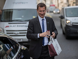 © Licensed to London News Pictures. 12/05/2016. London, UK. Health Secretary Jeremy Hunt is seen after leaving a Pret a Manger cafe.  Junior doctors have agreed to hold off on further strike action ahead of new talks in their long running dispute with the government over new contracts. Photo credit: Peter Macdiarmid/LNP