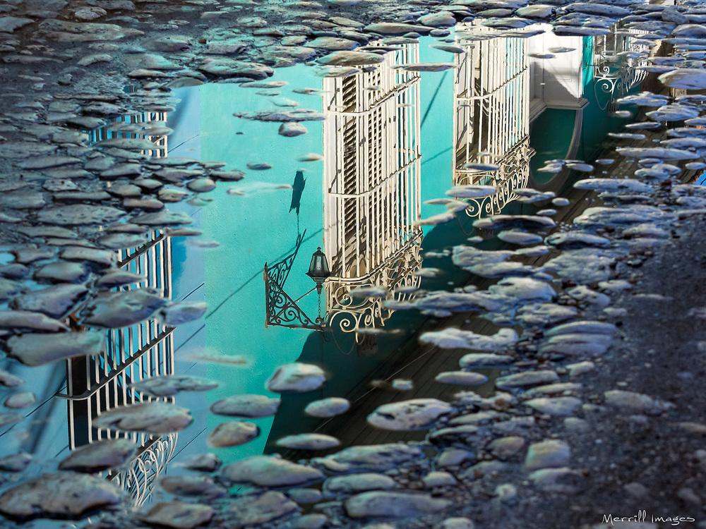 Reflection in cobblestone street.  Trinidad, Cuba