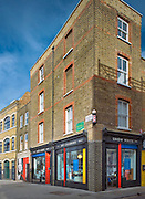 andy spain architectural photography brick building with shops underneath london
