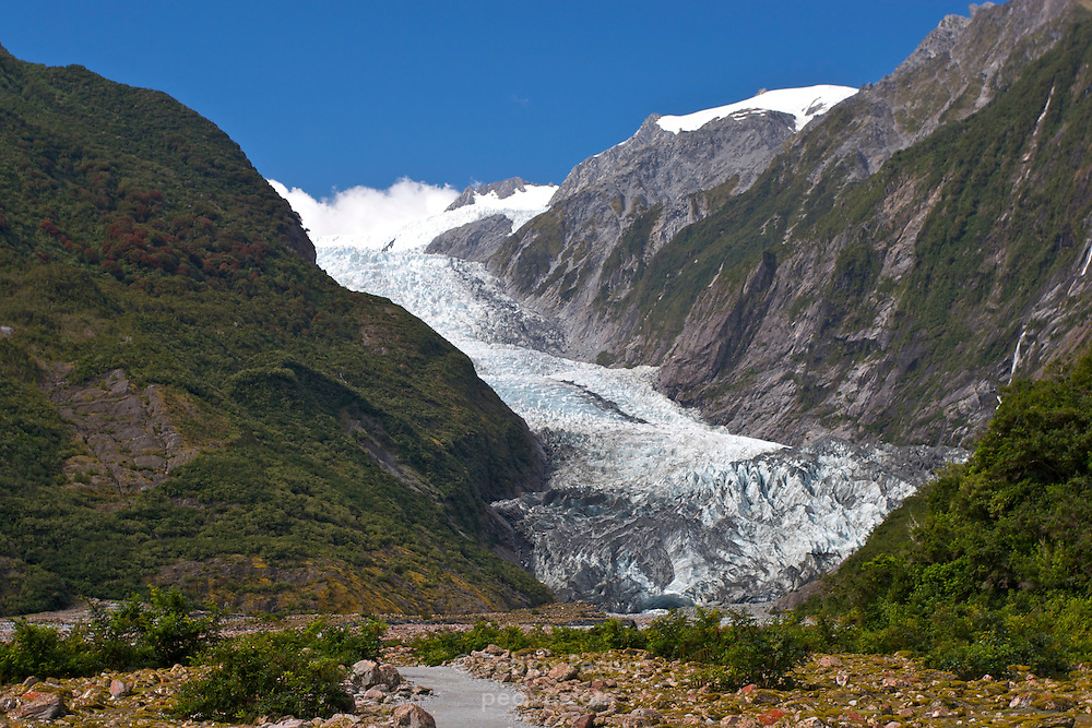 View of the Franz Josef Glacier, with the terminal face and the terminal cave visible. Franz Josef Glacier is part of the Westland National Park in southern New Zealand.