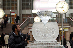 © Licensed to London News Pictures. 12/01/2012. London, UK.  Ice sculptor, Asanga Amerasinghe puts the final touches on a giant Jubilee diamond made of ice in Canary Wharf's Reuters Plaza to celebrate the Queen's diamond jubilee this year. In advance of the London Ice Sculpting Festival which starts tomorrow (13/01). Photo credit : James Gourley/LNP