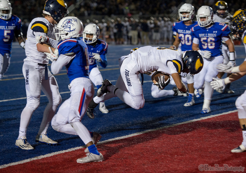 Oak Ridge Trojans Justin Poerio (19), dives for a touchdown to lead 10-0 after the point after attempt was good during the second quarter as the Folsom High School Bulldogs varsity football team host the Oak Ridge High School Trojans,  Friday Nov 4, 2016.<br /> photo by Brian Baer