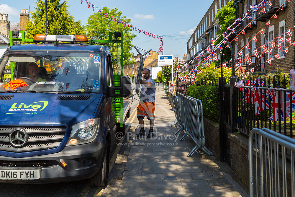 Workers collect crowd barriers on the day following the wedding of Prince Harry to Meghan Markle in Windsor, Berkshire. WINDSOR, May 20 2018.