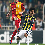 Fenerbahce's Cristian Oliveira Baroni (R) and Galatasaray's Selcuk Inan (L) during their Turkish superleague soccer derby match Fenerbahce between Galatasaray at Sukru Saracaoglu stadium in Istanbul Turkey on Saturday 17 March 2012. Photo by TURKPIX