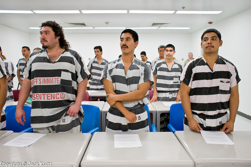 """06 NOVEMBER 2006 - PHOENIX, AZ: Prisoners in the Maricopa County Jail in Phoenix, AZ, take English classes offered to Spanish speaking prisoners in the jail. Maricopa County Sheriff Joe Arpaio is offering intensive two week English classes in the Maricopa County Jails so county prisoners can communicate with Detention Officers. The classes teach """"jail English"""" so inmates can report medical problems, request their lawyers, request bedding etc. There are more than 1,000 illegal immigrants in the county jail system. In 2011, the US Department of Justice issued a report highly critical of the Maricopa County Sheriff's Department and the jails. The DOJ said the Sheriff's Dept. engages in widespread discrimination against Latinos during traffic stops and immigration enforcement, violates the rights of Spanish speaking prisoners in the jails and retaliates against the Sheriff's political opponents.      PHOTO BY JACK KURTZ"""