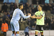 Bournemouth Forward Callum Wilson (13) shaking hands with Millwall goalkeeper Jordan Archer (1)  during the The FA Cup 3rd round match between Millwall and Bournemouth at The Den, London, England on 7 January 2017. Photo by Matthew Redman.