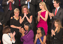 """Carryn Owens (black dress), the widow of William """"Ryan"""" Owens, a Navy SEAL killed in the Trump administration's first counterterrorism operation in Yemen is acknowledged by U.S. President Donald J. Trump during his address to a joint session of Congress on Capitol Hill in Washington, DC, USA, February 28, 2017. Photo by Chris Kleponis/CNP/ABACAPRESS.COM"""