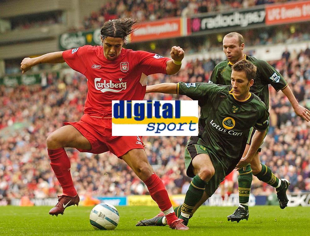 Fotball<br /> England 2004/2005<br /> Foto: SBI/Digitalsport<br /> NORWAY ONLY<br /> <br /> Liverpool v Norwich City, Barclays Premiership, 25/09/2004.<br /> Liverpool's Milan Baros (L) evades the challenge of Norwich's Adam Drury
