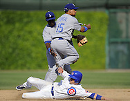 CHICAGO - MAY 30:  Rafael Furcal #15 of the Los Angeles Dodgers turns a double play, with the helping hand of Orlando Hudson #13, over a sliding Ryan Theriot #2 of the Chicago Cubs during the game on May 30, 2009 at Wrigley Field in Chicago, Illinois.  The Cubs defeated the Dodgers 7-0.  (Photo by Ron Vesely)