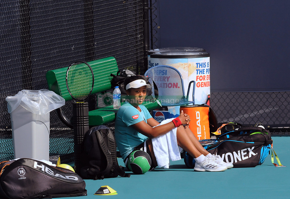 March 21, 2019 - Miami, FL, United States - Naomi Osaka of Japan takes a break while hitting shots on the practice courts at the Hard Rock Stadium at the Miami Open on March 21, 2019 in Miami Gardens, Florida. (Credit Image: © Paul Hennessy/NurPhoto via ZUMA Press)