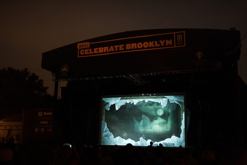 The Tiger Lillies performing behind a scrim showing an Antarctic scene from Coleridge;s Rime of the Ancient Mariner.