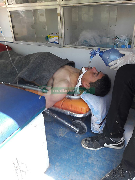 April 4, 2017 - Hatay, Hatay Province, Turkey - A young man getting help in a ambulance, after being a part of a supposed nerve gas attack (possibly the powerful and lethal sarin nerve gas) in north-western Syria. First reports place the death toll at 70 to 100, many childern. Several reported that airstrikes had targeted clinics treating the wounded. Khan Sheikhoun, Idhib Province is a rebel-held town of 165,000. Around 30 Turkish ambulances gathered at the border in Hatay Province for medical evacuation of victims after the Syrian toxic gas attack, to be brought to Turkey for immediate medical aid. (Credit Image: © Ferhat Dervisoglu/Depo Photos via ZUMA Wire)