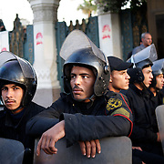 December 08, 2012 - Cairo, Egypt:  Intervention Police takes guard outside the presidential Palace in central Cairo...Sporadic clashes between supporters and opponents of president Mohamed Morsi, erupted in the past week over his assumption of extraordinary powers and the scheduling of a referendum on a disputed draft of the new constitution...Thousands of opposition protesters rallied outside the palace, in Cairo's Tahrir Square, and in cities and towns across the country, calling for an end to Mr Morsi's power grab and the shelving of the draft constitution. (Paulo Nunes dos Santos/Polaris)