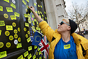 Put It To The People march for a Peoples Vote on 23rd March 2019 in London, United Kingdom. Outside the Cabinet Office, demonstrators had defaced the doors with anti Brexit stickers. With less than one week until the UK is supposed to be leaving the European Union, the final result still hangs in the balance and protesters gathered in their tens of thousands to make political leaders take notice and to give the British public a vote on the final Brexit deal.