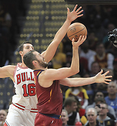 October 24, 2017 - Cleveland, OH, USA - The Cleveland Cavaliers' Kevin Love is fouled by the Chicago Bulls' Paul Zipser, left, during the fourth quarter on Tuesday, Oct. 24, 2017, at Quicken Loans Arena in Cleveland. The Cavs won, 119-112. (Credit Image: © Phil Masturzo/TNS via ZUMA Wire)