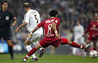 4/2/2004 Madrid, Spain.<br />Copa Del Rey (Spanish Cup) Semifinals. 1 Leg.<br />R.Madrid 2 - Sevilla 0<br />R.Madrid's Zidane in duel with Sevilla's Daniel Alves at Santiago Bernabeu's Stadium.