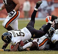 MORNING JOURNAL/DAVID RICHARD<br /> Linebacker Mike Peterson of Jacksonville lands on Cleveland quarterback Charlie Frye during a sack yesterday.
