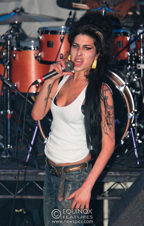 Singer Amy Winehouse, DOB=14/09/1983, performing for her gay fans at the G-A-Y Club. G-A-Y is London's biggest gay club and is held at the London Astoria nightclub, Soho, London, UK. Amy spent much of the show rubbing her itchy nose. She also seemed to have signs of old scars all down one arm...Picture Data:.Photographer: Edward Hirst.Copyright: ©2007 Licensed to Equinox News Pictures +448700 780000.Contact: Equinox Features.Date Taken: 20070415.Time Taken: 014942+0000.www.newspics.com