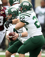 Ohio quarterback Tyler Tettleton (4) fakes a handoff to running back Beau Blankenship (22) against Louisiana-Monroe during the first quarter of the Independence Bowl NCAA college football game, Friday, Dec. 28, 2012, in Shreveport, La.