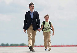Canadian Prime Minister Justin Trudeau and his son Xavier walk on the tarmac to board the government plane as they depart for Poland and Ukraine, Thursday, July 7, 2016, in Ottawa, Canada. Photo by Adrian Wyld/CP/ABACAPRESS.COM  | 554880_001 Ottawa Canada