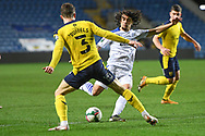 Tranmere Rovers midfielder (on loan from Crystal Palace) Nya Kirby (16) takes a shot at goal under pressure from Oxford United defender Josh Ruffels (3) during the EFL Trophy match between Oxford United and Tranmere Rovers at the Kassam Stadium, Oxford, England on 16 February 2021.