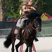 MILAN, ITALY - JUNE 05:  A woman wearing an amazon costume takes part in a mounted archery game during the 1st Palio Citta' di Milano  on June 5, 2010 in Milan, Italy. The Palio Citta di Milano is a re-enactment of a medieval tournament in which only women partake as commemoration of the courage displayed by local women during the Vigevano siege of 1449.  (Photo by Marco Secchi/Getty Images)