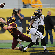 ORLANDO, FL - JANUARY 01:  Maxx Williams #88 of the Minnesota Golden Gophers misses a reception against Aarion Penton #11 of the Missouri Tigers during the Buffalo Wild Wings Citrus Bowl at the Florida Citrus Bowl on January 1, 2015 in Orlando, Florida. (Photo by Alex Menendez/Getty Images) *** Local Caption *** Maxx Williams; Aarion Penton