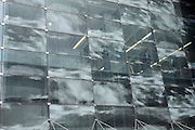 office building glass facade decorated with a cloud pattern