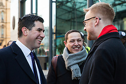 London, UK. 22nd January, 2019. Shadow Secretary of State for Justice and Shadow Lord Chancellor Richard Burgon (l) shows solidarity for support staff at the BEIS represented by the Public and Commercial Services (PCS) union on the picket line after beginning a strike for the London Living Wage of £10.55 per hour and parity of sick pay and annual leave allowance with civil servants. The strike is being coordinated with receptionists, security staff and cleaners at the Ministry of Justice (MoJ) represented by the United Voices of the World (UVW) trade union.