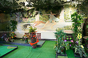 Crazy Golf at Efes Snooker Club on 18th November 2015 in East London, United Kingdom. A popular, rough and ready, Turkish Snooker and Pool hall, popular with young hipsters in Dalston.